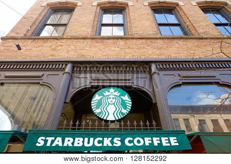 CHICAGO, IL - CIRCA MARCH, 2016: exterior of Starbucks Cafe. Starbucks Corporation is an American global coffee company and coffeehouse chain based in Seattle, Washington