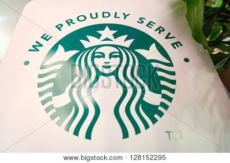 CHICAGO, IL - CIRCA MARCH, 2016: close up shot of Starbucks logo. Starbucks Corporation is an American global coffee company and coffeehouse chain based in Seattle, Washington