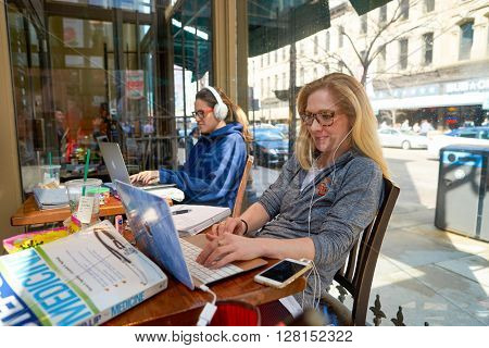 CHICAGO, IL - CIRCA MARCH, 2016: woman in Starbucks Cafe. Starbucks Corporation is an American global coffee company and coffeehouse chain based in Seattle, Washington