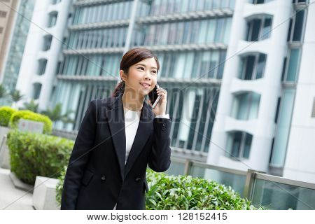 Businesswoman talk to mobilephone