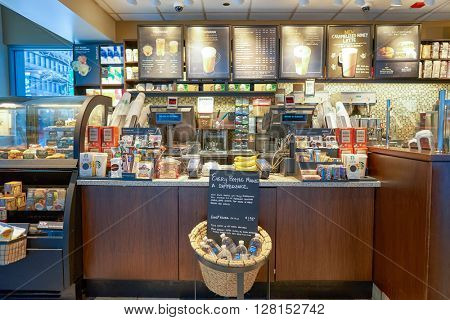CHICAGO, IL - CIRCA APRIL, 2016: inside of Starbucks Cafe. Starbucks Corporation is an American global coffee company and coffeehouse chain based in Seattle, Washington
