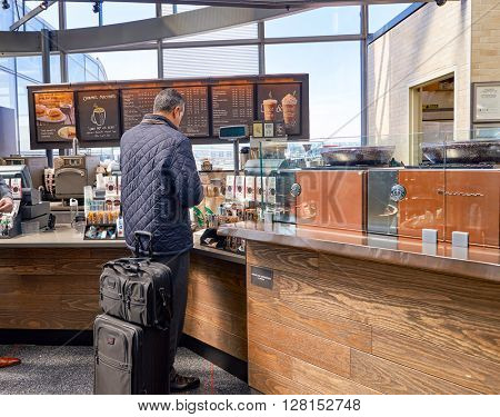 CHICAGO, IL - CIRCA APRIL, 2016: sales area in Starbucks Cafe. Starbucks Corporation is an American global coffee company and coffeehouse chain based in Seattle, Washington