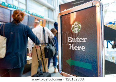 CHICAGO, IL - CIRCA APRIL, 2016: Starbucks Cafe at O'Hare Airport. Starbucks Corporation is an American global coffee company and coffeehouse chain based in Seattle, Washington