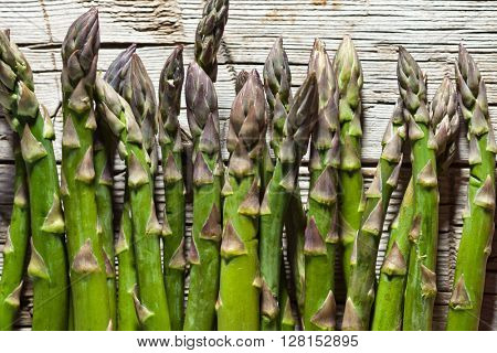 fresh asparagus on rustic wooden background