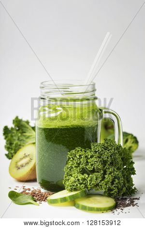 Healthy green smoothie and ingredients on white  - superfoods, detox, diet, health, vegetarian food concept