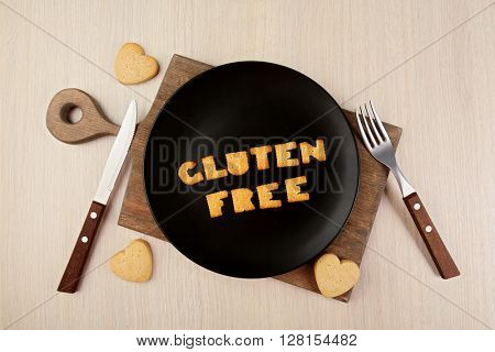 Gluten free made of crackers on baking utensil over wooden table