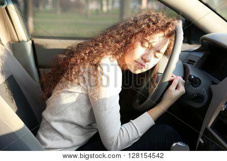Woman sleeping in car