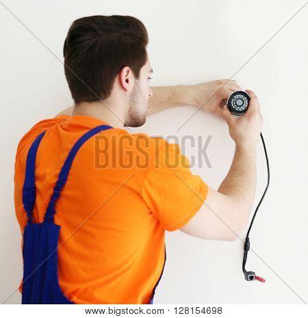 Professional CCTV technician working.