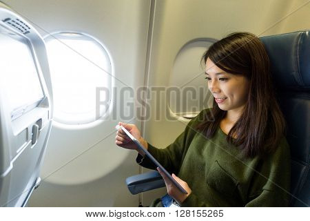 Woman use of tablet pc at plane