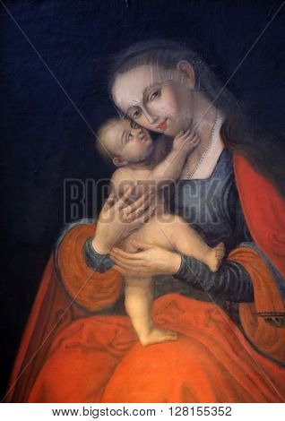 BENEDIKTBEUERN, GERMANY - OCTOBER 19: Virgin Mary with baby Jesus, altarpiece in Saint Benedict basilica in the famous Benediktbeuern abbey, Germany on October 19, 2014.