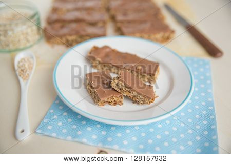 Home made healthy chocolate granola bars on a plate ** Note: Shallow depth of field