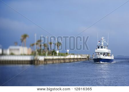Ferry boat heading into port on Bald Head Island, North Carolina.