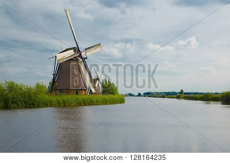 Old windmill on dutch landscape