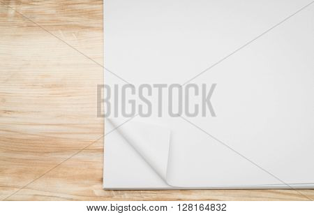 Real Paper Corner Fold on wood background