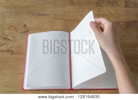 Hands open Blank catalog, magazines,book mock up on wood table