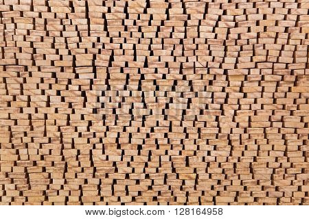Backgrounds of the ends of processed lumber stacked on the open air