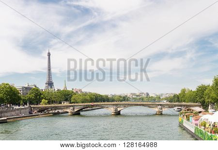 Panorama of Eiffel Tower along river seine, Paris France
