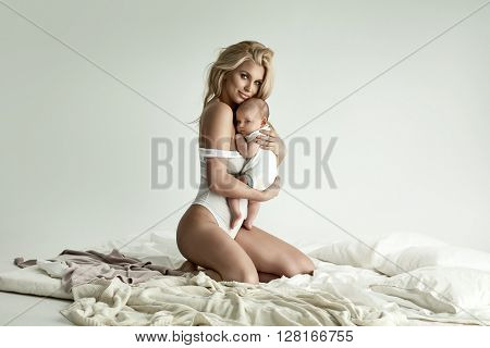 Happy blonde mother and baby