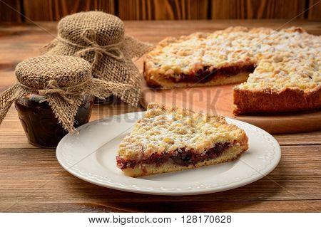 Cherry tart  on brown  wooden background .