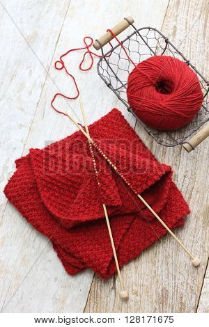 hand knitted red scarf, yarn ball and knitting needles, handmade christmas present