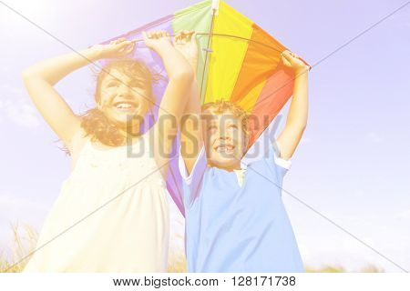 Little Girl And Little Boy Playing Kite Together Concept