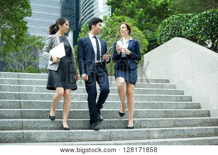 International business group of people walking outside office