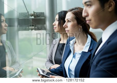 Business team looking out of window
