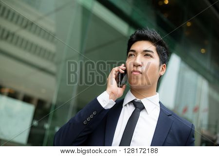 Business man talking on a cell phone