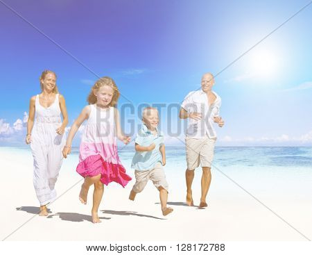 Family having fun on a beach.Young family enjoying their summer vacation.