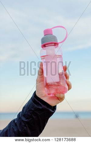 bottle of water in the hand