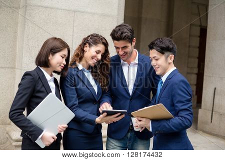 International business team discuss on tablet