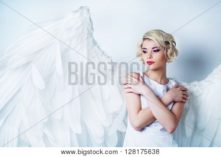 beautiful model with makeup and angel wings