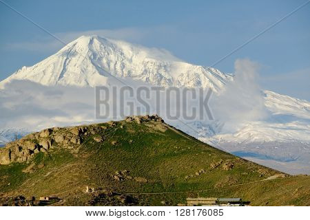 Hill landscape at morning in Armenia with Ararat mountain at background