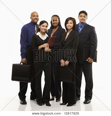 Multi-ethnic business group of men and women standing with briefcases looking at viewer.