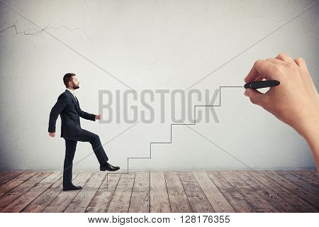 Businessman in a formal wear climbing drawn stairs, side view