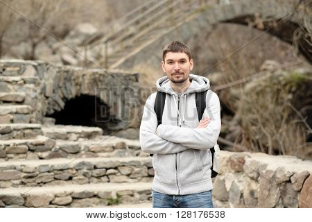 Man with backpack traveling in Armenia