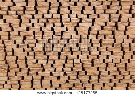 Backgrounds of the ends of processed lumber stacked on the open air close-up