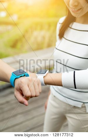 Woman use of smart watch with friends