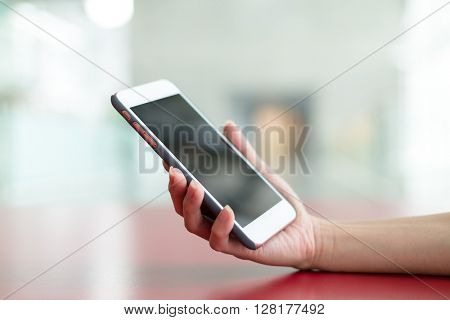 Human hand hold with cellphone