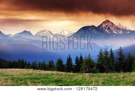 Fantastic views of the mountain range with snow peaks at twilight. Dramatic and picturesque scene. Location place Salzburg. Austria, Europe. Artistic picture. Beauty world.