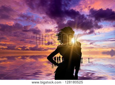 Silhouette of people on the beach at sunset