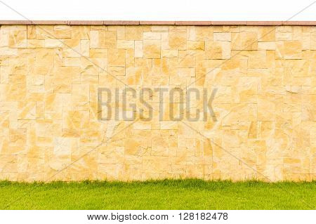 pattern color of modern style design decorative real stone fence surface with cement on grass field
