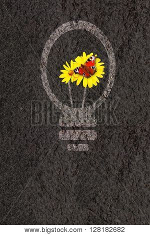 Eco background with flowers, soil and light bulb silhouette