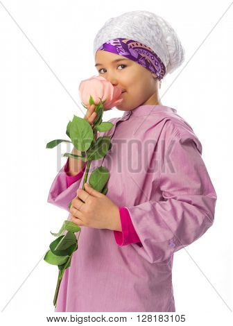 Little girl in traditional muslim clothes with rose flower isolated