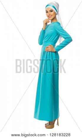 Young muslim woman in blue dress isolated
