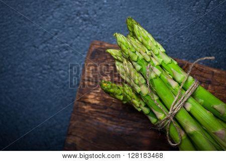 Fresh asparagus on a dark  background