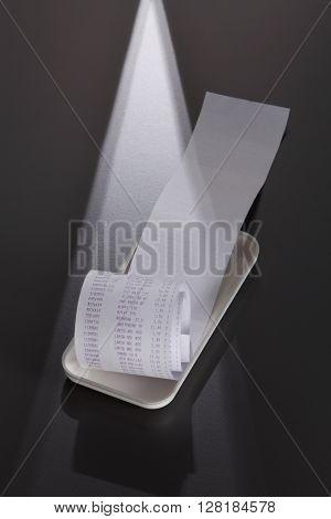Receipt on a white tray.