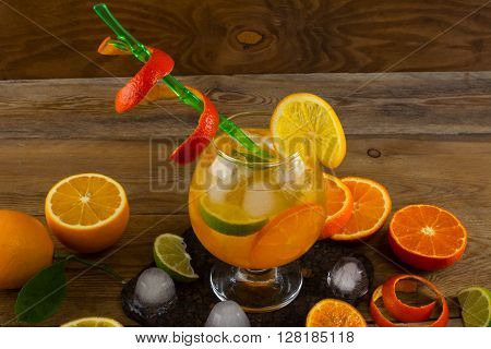 Cool citrus cocktail on wooden table. Fruit cocktail. Fruit drink. Citrus lemonade. Fruit lemonade. Summer drink