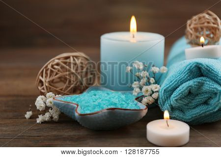 Spa still life in light blue color on wooden background