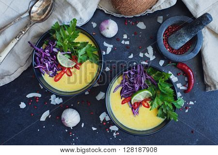 Thai coconut creamy soup with fresh vegetables. Vegan healthy food.